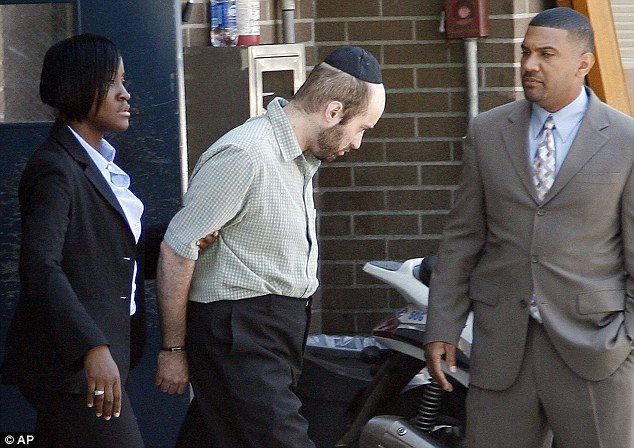 Charged: Police walk Levi Aron, centre, to a police car in Brooklyn. He has pleaded not guilty to first-degree murder, but has allegedly admitted to police that he abducted Leiby and took him to a wedding