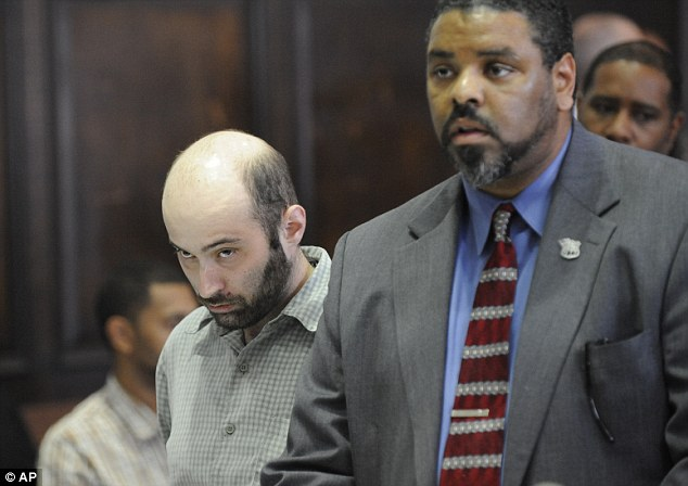 Accused: Levi Aron listens as his other defence lawyer Pierre Bazile speaks at his arraignment in Brooklyn