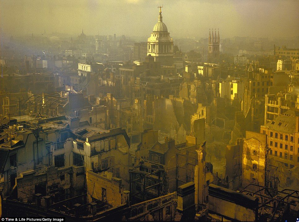 Standing tall: The spire of the Central Criminal Court - better known as the Old Bailey - rises defiantly in a landscape scarred by a heavy German air raid