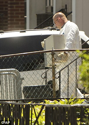 Investigation: Police remove a computer from Levi Aron's home