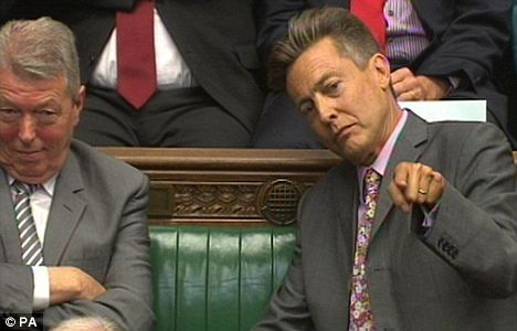 Drowned out: Alan Johnson (left) smiles as Ben Bradshaw leans to listen to the loudspeaker mounted in the back of his bench