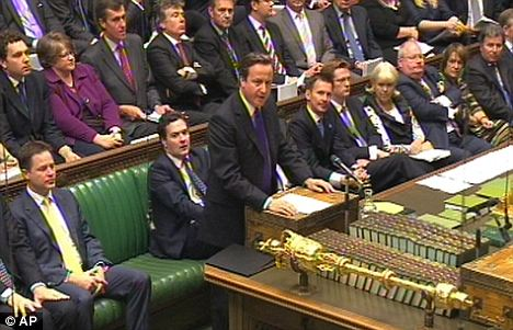Mind your PMQs: David Cameron during Prime Minister's Questions in the House of Commons, London, on Wednesday defended his former aide Andy Coulson
