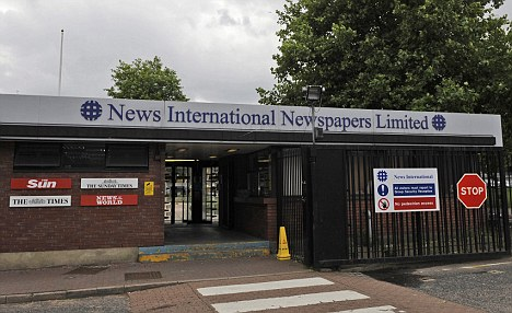 Escorted: Reports said Nixson was marched out of the building by security staff at News International's Wapping HQ
