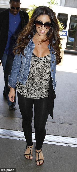 Smiley: Melissa slipped into a pair of form-fitting leggings teamed with sandals, a low cut top and denim jacket