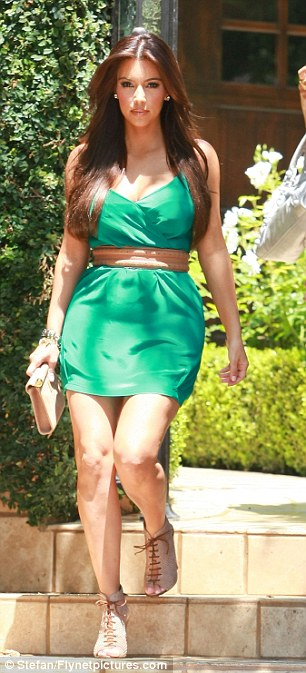 Sexy strut: Kim looks ready to conquer the world - and that includes Old Navy -  while out and about in Beverly Hills yesterday