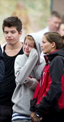 Tears: Norwegian Prime Minister Jens Stoltenberg (back to camera) meets with victims