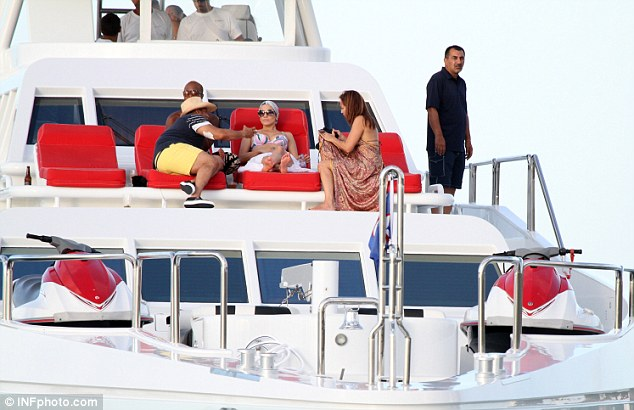 Lap of luxury: The singer is staying on the Oceanfast super yacht Never Say Never