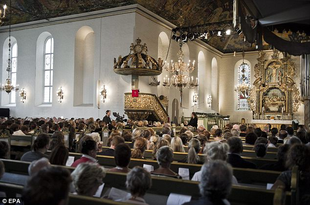 Paying respects: A 'mass for sorrow and hope' is held in Oslo Cathedral following the gruesome attacks