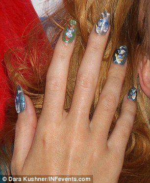Quirky: Even Katy's nails were themed, with a different Smurf on each finger