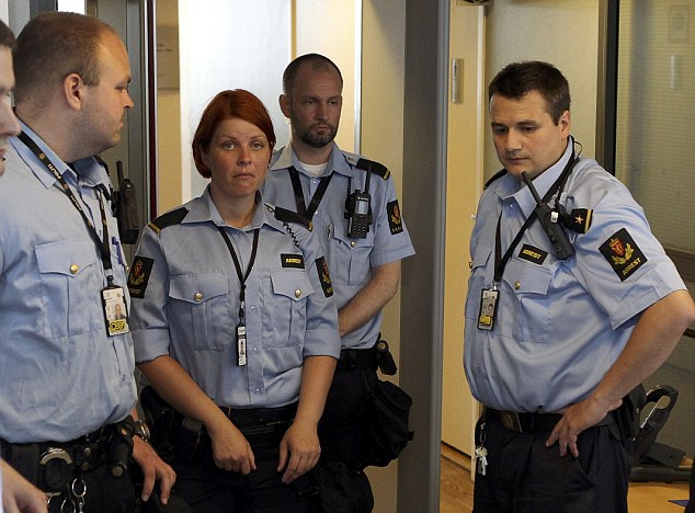 Closed hearing: Security guards at the entrance of the court in Oslo where Anders Behring Breivik is due to appear later today