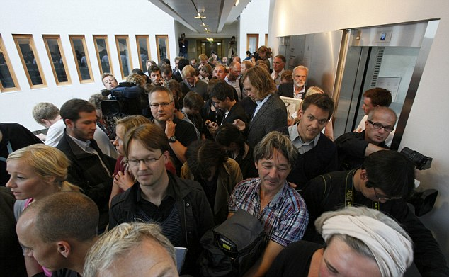 Huge interest: Journalists queue inside the building to try and get a space in court