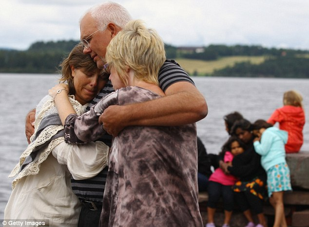 Comfort: Relatives of the victims gather to observe a minute's silence opposite Utoya island