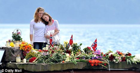 Two young women pay their respects at a shrine set up near Utoya Island