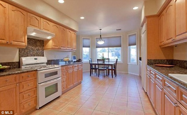 All new: The kitchen has wood cabinets and granite counter tops as well as views over the canyon