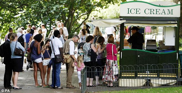 Popular: Holidaymakers queue for ice creams in Green Park, London