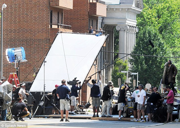 Big production: Onlookers were eager to get a glimpse of the movie set which shut off street in the Oakland area of city