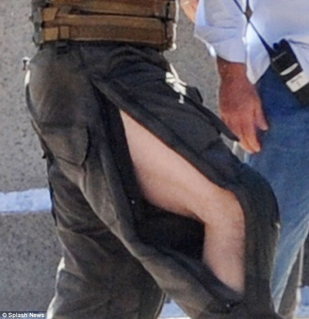 Flashing the flesh: Hardy - why plays villain Bane - ended up with a 'wardrobe malfunction' of ripped trousers after the fight sequence
