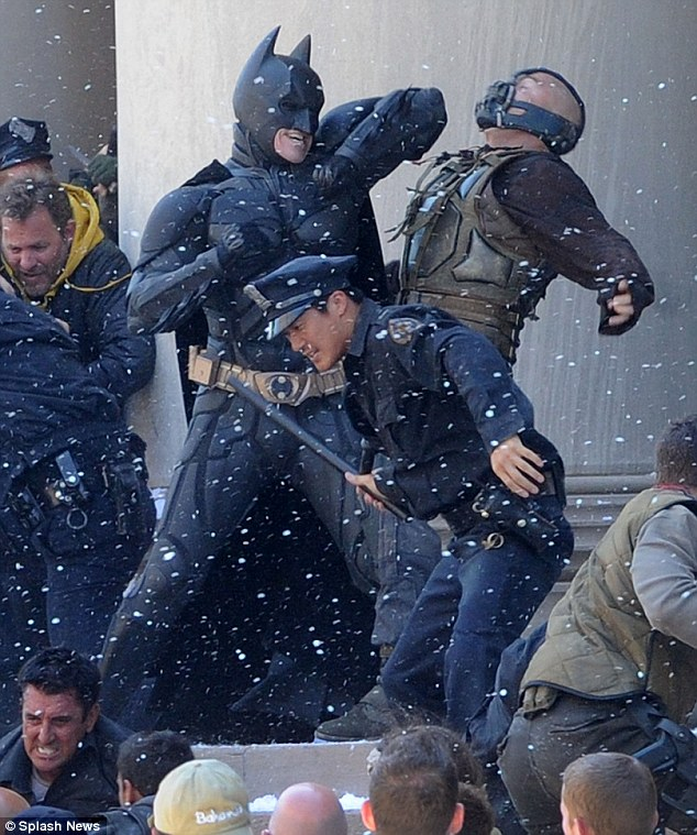 Kapow: Christian Bale and Tom Hardy fight it out while filming scenes for upcoming movie The Dark Knight Rises in Pittsburgh today