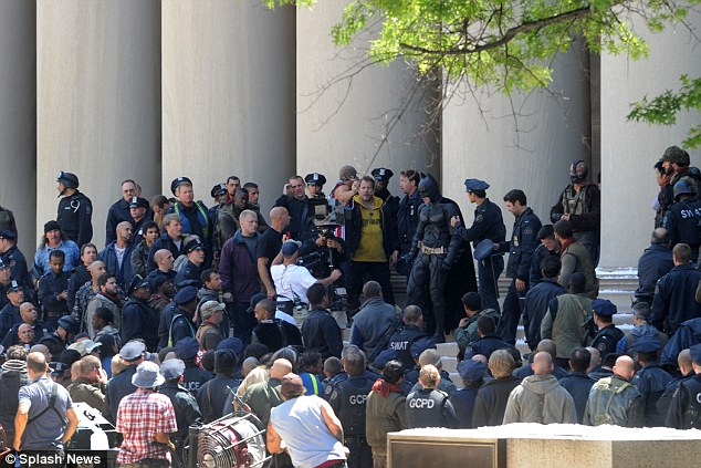 Causing a commotion: The scene had hundreds of extras dressed as police men and bad guys fighting in front of the building