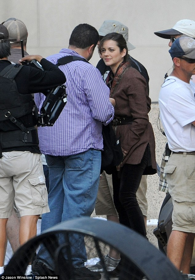 Ready for her close-up: Marion Cotillard was also seen filming scenes today as her character Miranda Tate