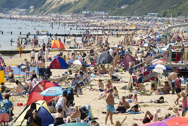 Bathing in Bournemouth: Holidaymakers flocked to the sandy beach on Monday