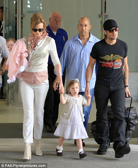 Family time: Nicole with husband Keith Urban, seen last month, who has been accused of attacking a photographer's car