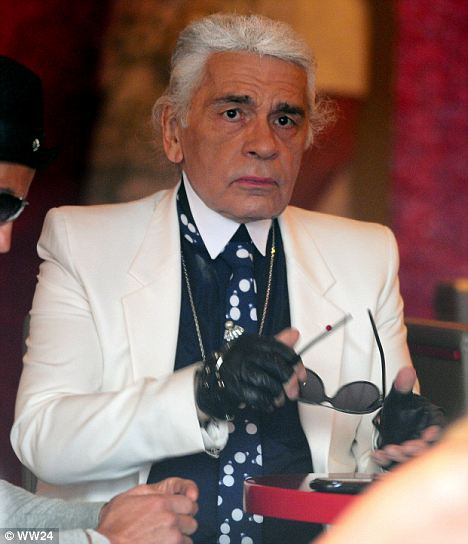 Bright eyes: Karl Lagerfeld is spotted in a rare moment without his trademark dark glasses