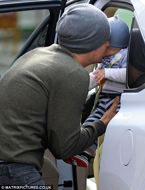 Too cute: Daddy and baby appeared to be wearing matching grey hats