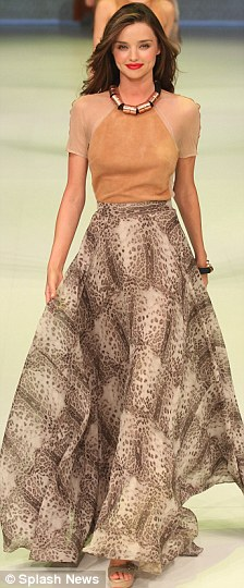 Seventies style: Miranda wore a retro pants suit and dress too as part of the Sydney fashion show
