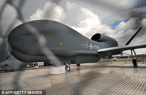 Costly: A Global Hawk unmanned aircraft sits on a runway. The U.S. will spend $23billion on the crafts in order to replace its U-2 spy planes