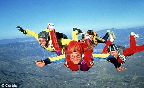 Group jump: The 29-year-old took the plunge with others near her home in Dundee. Here a group jumps safely
