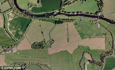 Drop zone: An aerial view of the skydive site showing where Zoe Sievwright was meant to land (marked red) and where  she did land (blue circle)