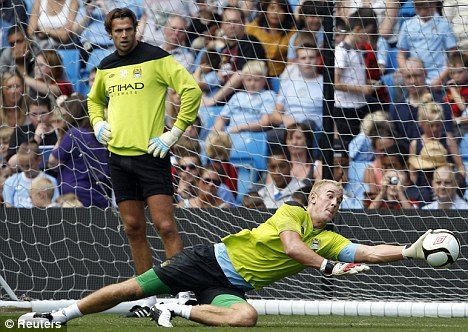 Hard to beat: City goalkeeper Joe Hart makes a save