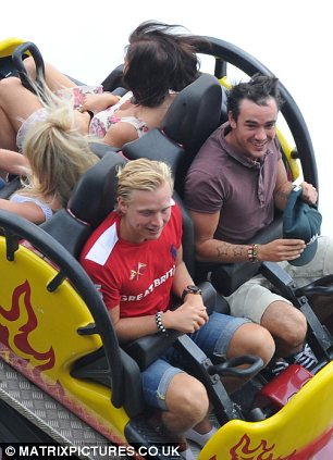 Hold on tight: Jessica Wright enjoys the rides at Chessington, with Jack Tweed perched behind her
