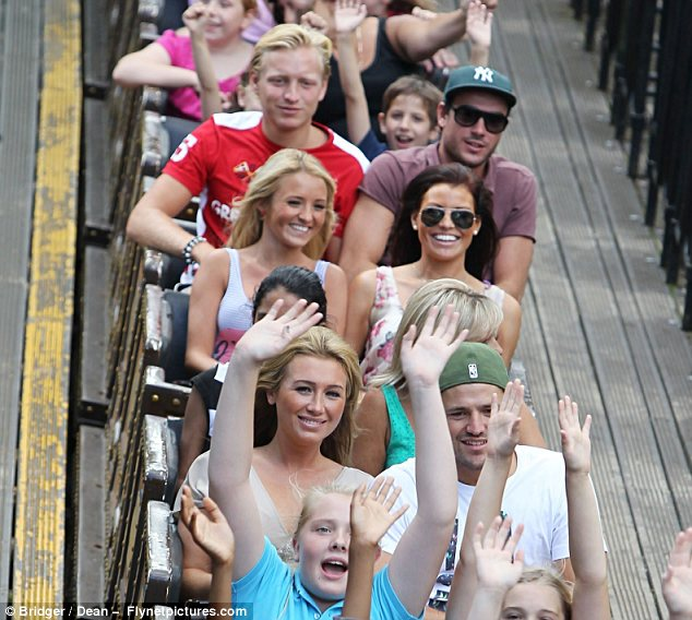Too cool for school: While everyone else throws their hands in the air, TOWIE cast keep hands inside the ride