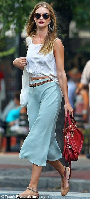 Rosie Huntington-Whiteley  wears a midi