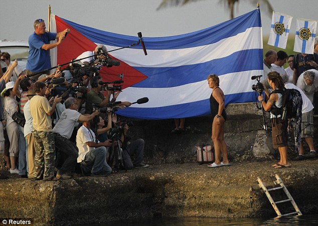 U.S. swimmer Diana Nyad poses for reporters before her attempt to swim to Florida from Havana, at dusk on Sunday morning
