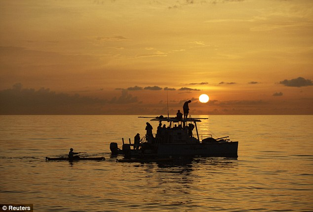 The sun sets as an assistance boat follows Nyad on her grueling route
