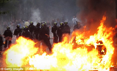 Ablaze: The riots have led to several football matches being cancelled