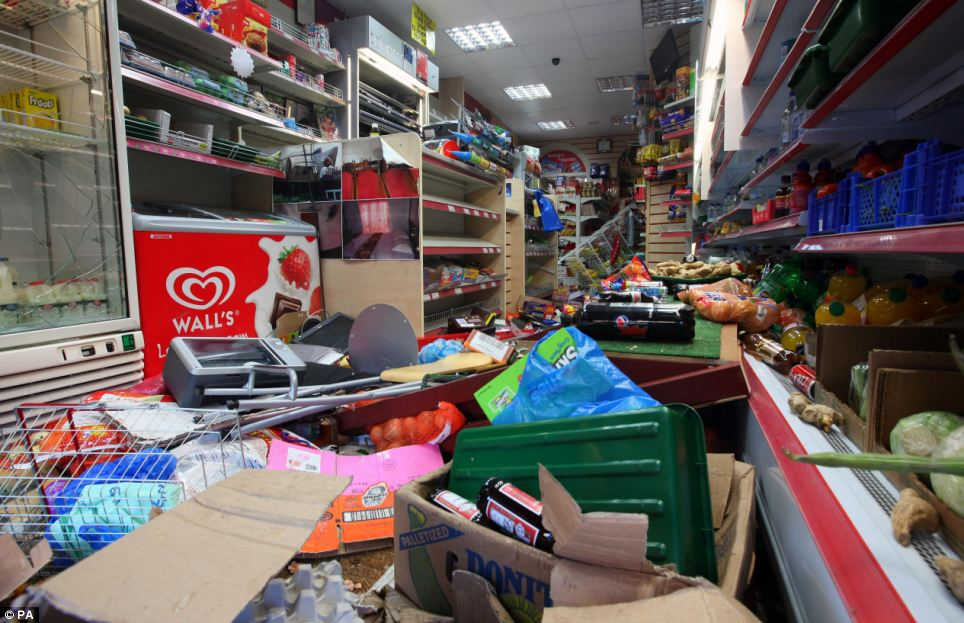 Smashed: An internal view of damage to shop on London Road in Croydon