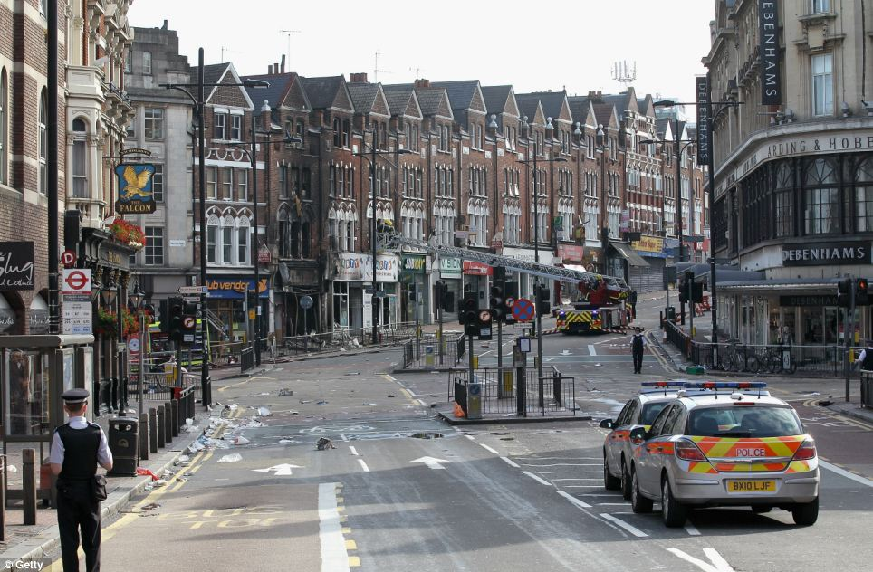 Carnage:  The high street close to Clapham Junction was covered in debris after hundreds of people went on the rampage. The Debenhams store, right, was ransacked and looted
