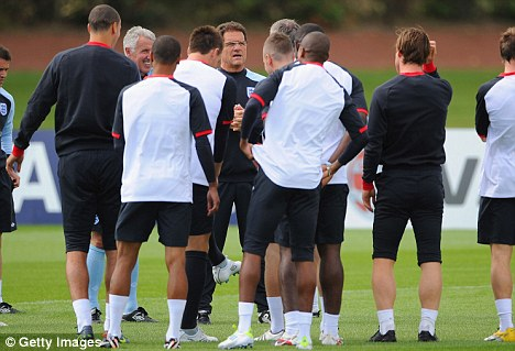 All over: England manager Fabio Capello speaks to his squad