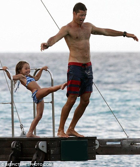 Ooops: David gets a helping hand into the water by his daughter who pushes him off the platform