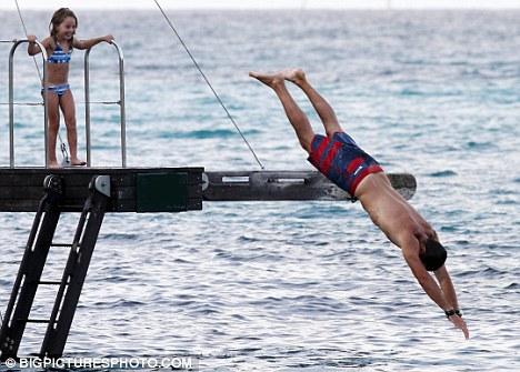 Brace for impact: David showed off his diving talents as his daughter looked on laughing