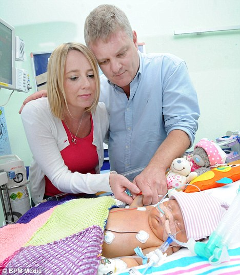 Despair: Chris and Julie Bryon-Edmond, from Torquay, Devon, couldn't spend the night with their daughter at Birmingham Children's Hospital because of thugs