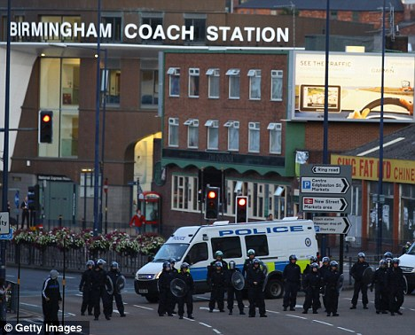 Rioting and looting: Police dispersed in Birmingham City Centre yesterday after three nights of rioting in London