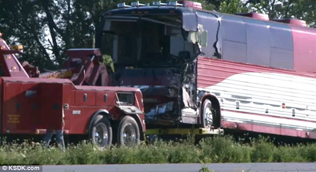 Damaged: The tour bus appears to have sustained significant damage after it hit an overturned truck that was immobile due to an earlier accident