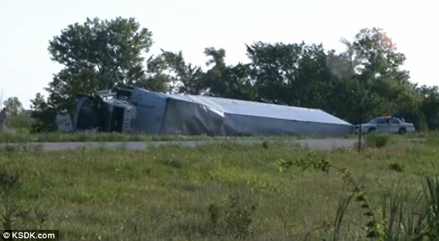 Double jeopardy: Police were already on the scene when the tour bus hit the overturned truck