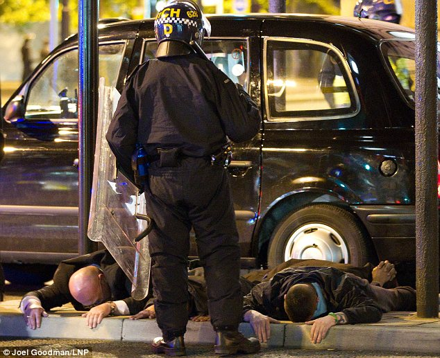 A man believed to be Domenyk Noonan lies face down on the ground in Manchester during the riots