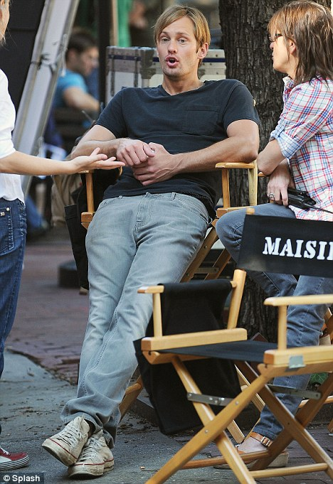 Quick break: Skarsgard takes a seat as he has some time out between takes